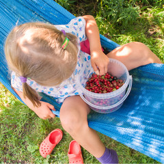 Little girl eating berries