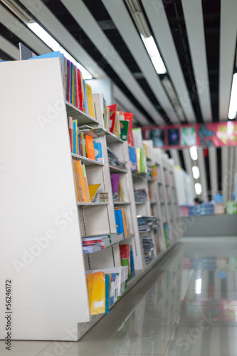 The aisles in a public library with shelves full of books