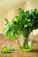 Fresh parsley in a green glass
