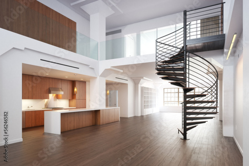 Empty room of residence with a spiral staircase