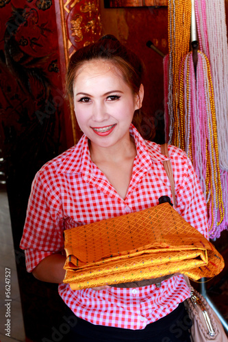 Thailand women's holding a gold fabric