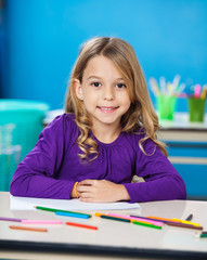 Girl With Sketch Pens And Paper In Kindergarten