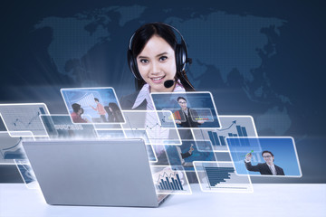 Businesswoman with digital photos on blue