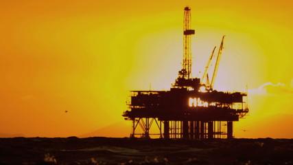 Silhouette Oil Platform at Sunset