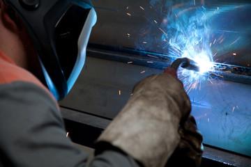 Factory welder at work