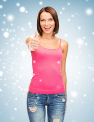 woman in blank pink tank top showing thumbs up