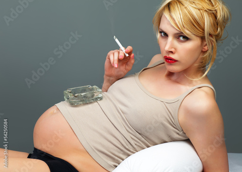 Pretty pregnant with a cigarette