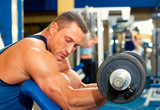 Man with weight training equipment on sport club