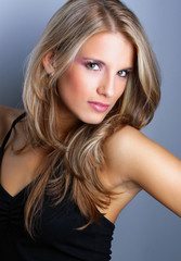 Studio shot of pretty young woman