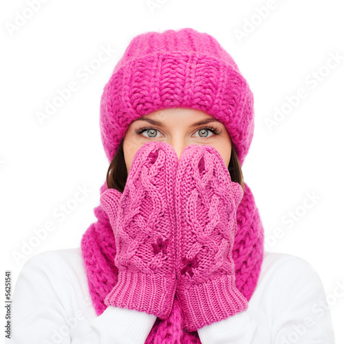 surprised woman in hat, muffler and mittens