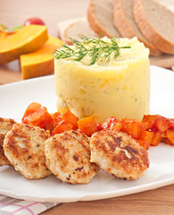 Fried cutlets, stewed pumpkin and mashed potatoes
