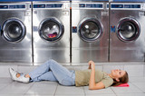 Woman Listening To Music While Lying At Laundry