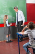 Schoolgirl And Male Teacher Looking At Each