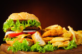Cheeseburger, fried chicken nuggets and french fries - 56254941