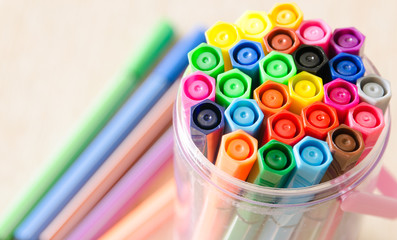 Felt-tip pens in a box.