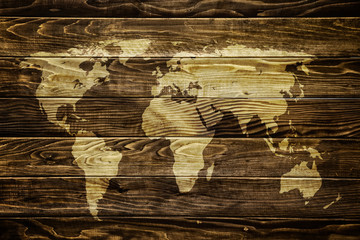 World map on wood background