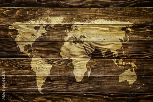 world-map-on-wood-background