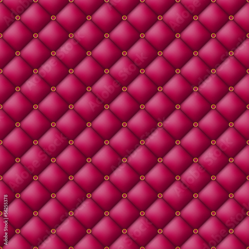 Button-tufted leather background.