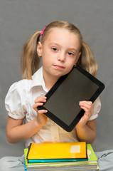 Schoolgirl with the tablet and notebooks.