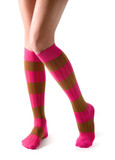Young woman legs posing with pink striped socks