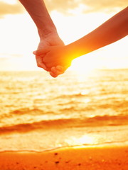 Love - couple holding hands in love, beach sunset