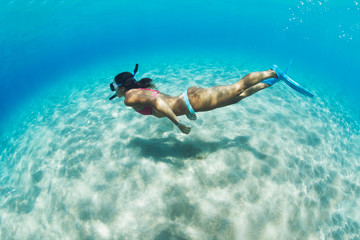 Woman snorkeling in tropical sea