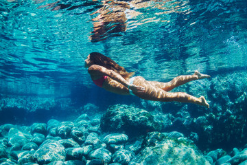 Woman floating in Natural Pool