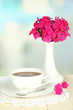 Beautiful bouquet of phlox with cup of tea