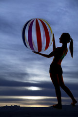 silhouette holding beach ball
