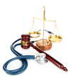 Medicine law concept. Gavel, scales and stethoscope isolated