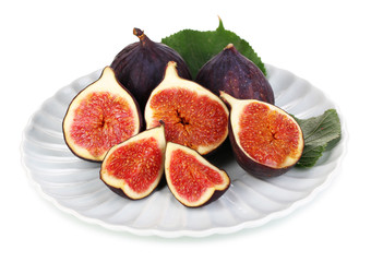 Ripe figs on plate  isolated on white