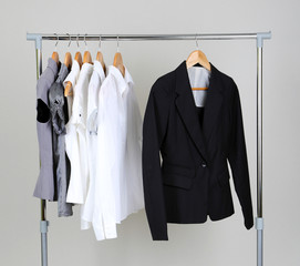 Office clothes on hangers, on gray background
