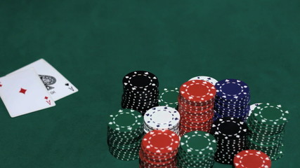 Casino. Stack of chips and two aces.