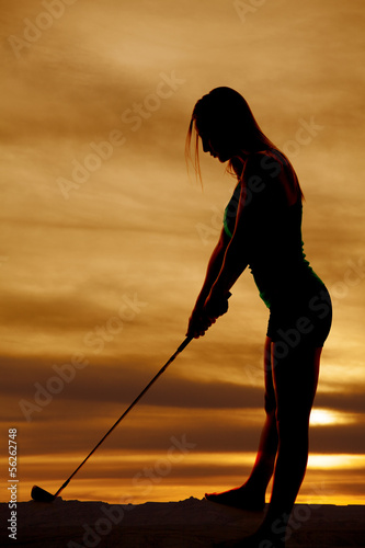 silhouette woman ready to swing club