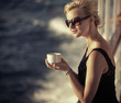 Beautiful girlresting woman with cup of coffee