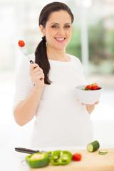 pregnant woman eating vegetable salad