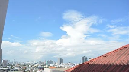 Clouds time lapse city skyline
