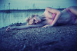 Tired blonde girl lying on the beach