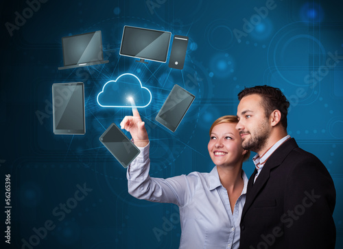 Happy couple touching cloud service