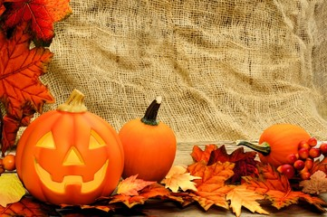 Halloween Jack o Lantern and leaf border with burlap background