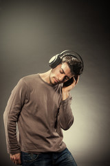 Man is listening to music while wearing headphones