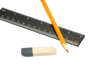 Pencils, eraser and ruler isolated on white