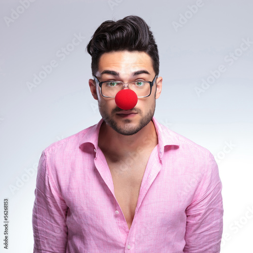 emotionless fashion young man with red nose