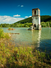 Ruins of the flooded Bezidu Nou in Transylvania, Romania