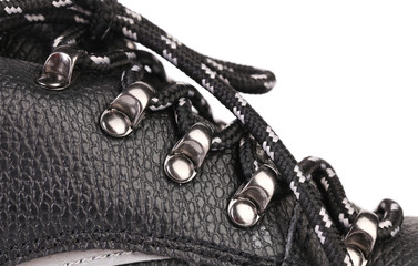 Shoelaces on boot close up and space for text.
