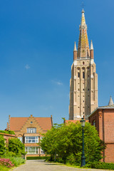 Our Lady Church in Bruges in a summer day