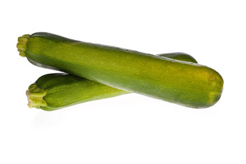 zucchinis or courgettes isolated on a white background.
