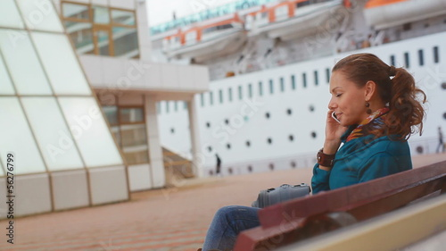 Young business woman sitting at the seaport
