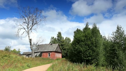 Movement of clouds over the old Russian wooden houses. Dvorets,