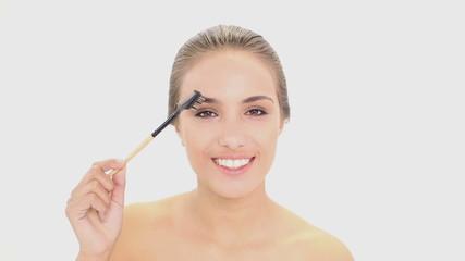 Beautiful model using an eyebrow brush